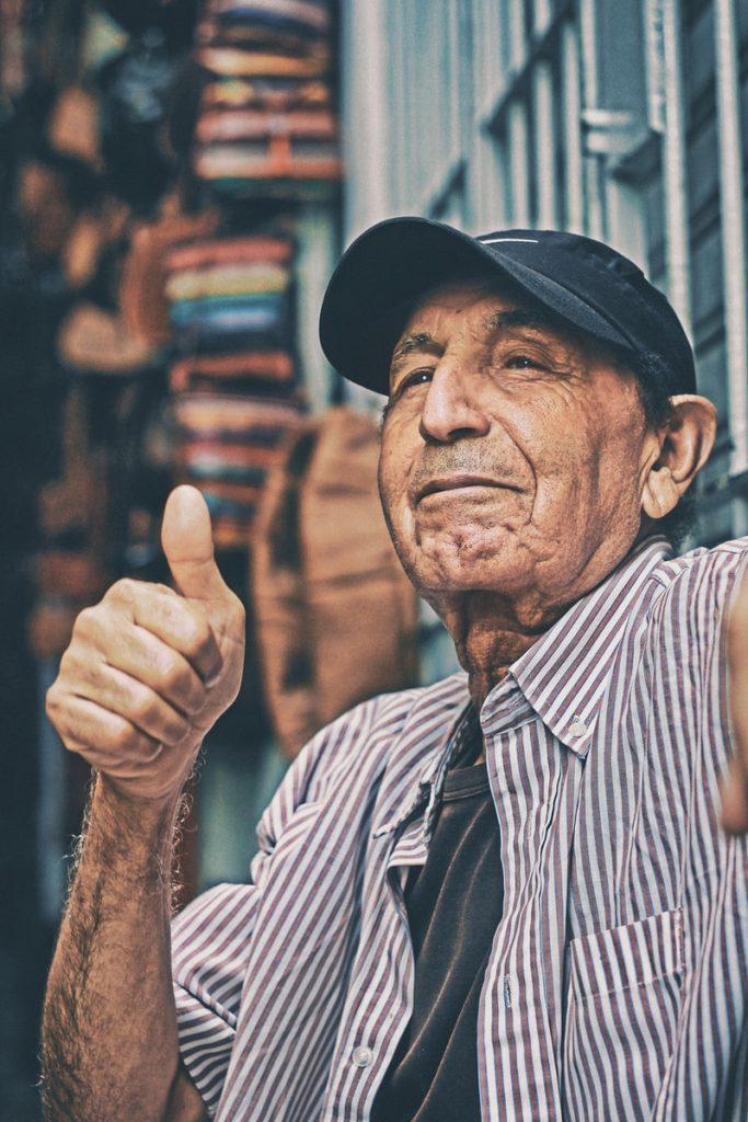 man making thumbs up sign